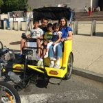 Family enjoys a Washington DC Pedicab Tour at the Smithsonian Air and Space Museum
