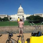 Pedicab Passengers Taking a Photo of the US Capitol