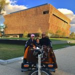 The new Smithsonian African American History Museum captures the rays of the set...